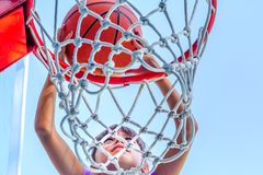 Seven year old girl  playing basketball Royalty Free Stock Images