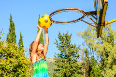 Seven year old girl playing basketball. Seven year old girl is playing basketball stock photography
