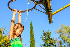 Seven year old girl playing basketball. Little seven year old girl is playing basketball stock image
