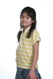 Seven year old girl standing Stock Image