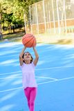 Seven year old playing basketball. Seven year old girl is playing basketball Royalty Free Stock Photo