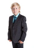 Seven years old blond schoolboy in school uniform, suit, shirt and tie, isolated white background Royalty Free Stock Images