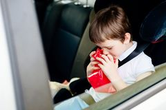 Seven years old child suffers from motion sickness Stock Photo
