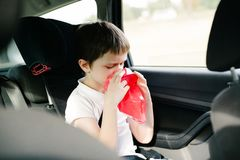 Seven years old child vomiting in car Stock Photography