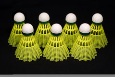 Seven yellow badminton shuttlecocks isolated on bl. Seven yellow badminton sport shuttlecocks isolated on black Stock Photos