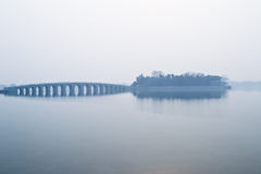 Seventeen Arch Bridge in the fog Stock Photography