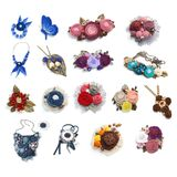 Seventeen female handmade decorations brooches, pendants, necklace made from different fabrics on a white background Stock Image