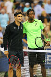 Seventeen times Grand Slam champion Roger Federer and Gael Monfils before quarterfinal match at US Open 2014 Royalty Free Stock Image