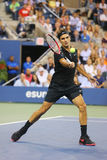 Seventeen times Grand Slam champion Roger Federer during quarterfinal match at US Open 2014 against Gael Monfils Stock Photography