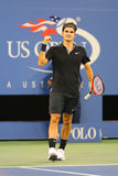Seventeen times Grand Slam champion Roger Federer during round 4 match at US Open 2014 Royalty Free Stock Photo