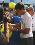 Seventeen times Grand Slam champion Roger Federer signing autographs after practice for US Open 2014 Stock Photography