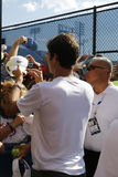 Seventeen times Grand Slam champion Roger Federer signing autographs after practice for US Open 2014 Stock Images