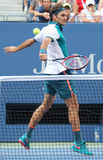 Seventeen times Grand Slam champion Roger Federer of Switzerland in action during his first round match at US Open 2015 Royalty Free Stock Photography