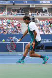 Seventeen times Grand Slam champion Roger Federer of Switzerland in action during his first round match at US Open 2015 Royalty Free Stock Images