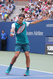 Seventeen times Grand Slam champion Roger Federer of Switzerland in action during his first round match at US Open 2015 Stock Images