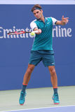 Seventeen times Grand Slam champion Roger Federer of Switzerland in action during his first round match at US Open 2015 Royalty Free Stock Photos