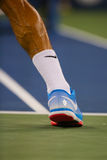 Seventeen times Grand Slam champion Roger Federer wears custom Nike tennis shoes during match at US Open 2014 Stock Photography