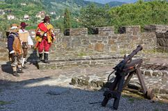Seventeenth Century Cannon at the Historical Reenactment at the. GORIZIA, Italy - May 6, 2018: Seventeenth century cannon and three costumed men at the stock photo