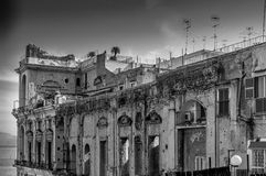 Seventeenth century  Palace. The Seventeenth century  Palace of Donn Anna with palm tree on the roof, Naples, Italy Royalty Free Stock Images