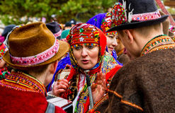 Seventh Ethnic Festival Christmas Carols in the old village. Uzhgorod, Ukraine - January 15, 2017: Participants in folklore collectives talking during the stock photo