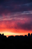 From seventh to sky hot heaven. Colorful fiery sky at sundown with cirrus clouds above the city skyline Royalty Free Stock Photography