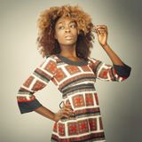 Seventies Fashion Shoot. African Caribbean Woman with afro hair with vintage seventies clothing Stock Images