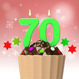 Seventy Candle On Cupcake Shows Elderly Stock Images