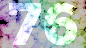 Seventy five to seventy six years birthday fade in/out animation with color gradient moving bokeh background. Animation: 90 frames still with number, 180 fade royalty free illustration