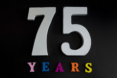 Seventy-five years. Figures and year on a black background Royalty Free Stock Images