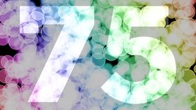 Seventy four to seventy five years birthday fade in/out animation with color gradient moving bokeh background. Animation: 90 frames still with number, 180 fade stock illustration