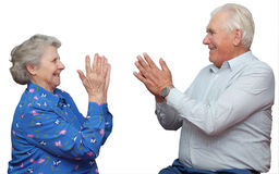 Seventy year old couple clap one`s hands Stock Image