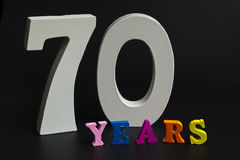 Seventy years. Figures and year on a black background Royalty Free Stock Photos
