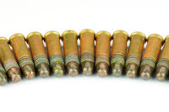 Several .22 caliber rifle rounds, on white Royalty Free Stock Image