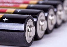 Several AA batteries in perspective closeup view Royalty Free Stock Image