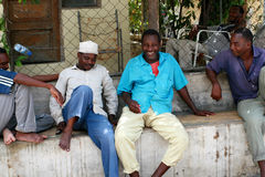 Several African men have a rest in the shade. Royalty Free Stock Image