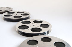 Several aluminum film reels. On a white background stock photography