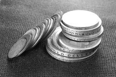 Several ancient silver coins close-up, black and white photo Stock Image