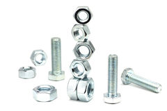 Several anodized bolts and nuts Royalty Free Stock Image