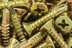 Several anodized screws background Stock Photo