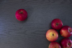 Several apples on a wood table . Royalty Free Stock Photo