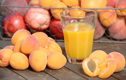 Several apricots and apricot juice drink Stock Photography