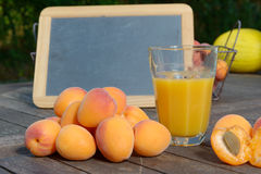 Several apricots and apricot juice drink Stock Image