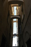 Several Arches between the tall buildings Royalty Free Stock Photos