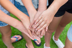 Several arms of girls with hands over each other Royalty Free Stock Photo