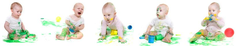 Several babies painting stock photos