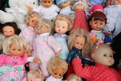 Several baby dolls on sale at the flea market royalty free stock photos