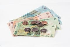 Free Several Banknotes Worth 100, 10 And 1 Romanian Lei With Several Coins Worth 10 And 5 Romanian Bani On A White Background Stock Photo - 103404470