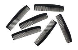 Several barber shop black combs Royalty Free Stock Photos