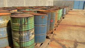 Several barrels of toxic waste glider footage stock footage