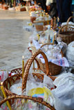 Several baskets with candles and cakes at Easter. Several baskets with candles, eggs and cakes for Easter Royalty Free Stock Photo
